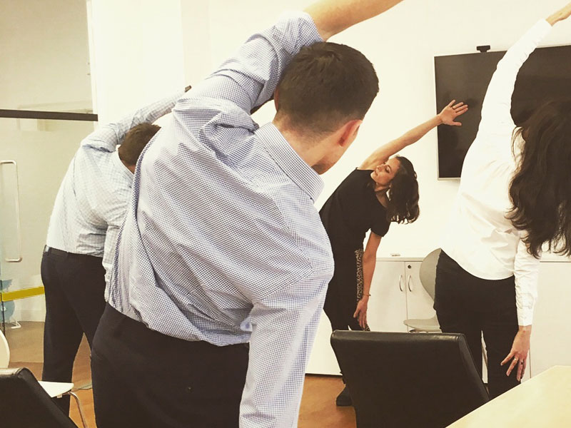 Office Yoga, Corporate Yoga, Desk and Chair Yoga, Guidepoint, Katichakrasana, lateral stretch, workplace yoga, yoga, yoga everywhere, wellness week, desk yoga, chair yoga, corporate health and wellbeing champion, yoga London