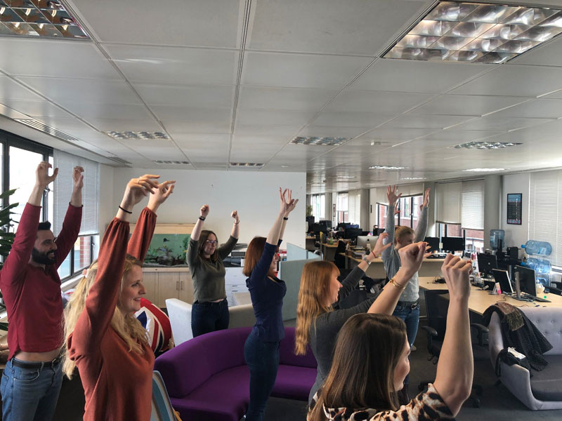 Office Yoga, Corporate Yoga, Standing yoga, workplace yoga, yoga, yoga everywhere, wellness week, desk yoga, chair yoga, corporate health and wellbeing champion, yoga London