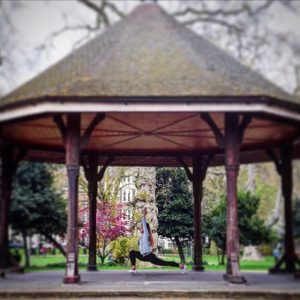 early morning yoga in the park at lincolnsinnfields yoga pose ashwasanchalanasana Simon Manterfield photo