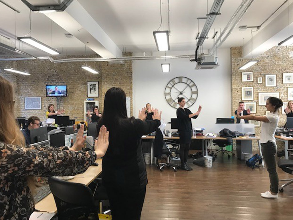 Standing yoga, Rostrum Agency, Suksham Vyayama, Kriya, workplace yoga, office yoga, yoga everywhere, wellness week, desk yoga, chair yoga, corporate health and wellbeing champion, yoga London