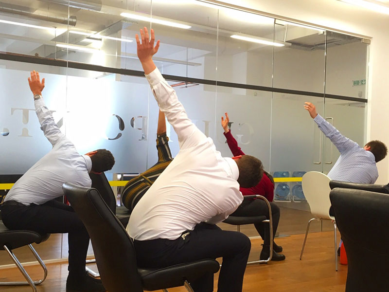 Office Yoga, Corporate Yoga, chair yoga, Guidepoint, Seated Triangle Pose, workplace yoga, yoga, yoga everywhere, wellness week, desk yoga, chair yoga, corporate health and wellbeing champion, yoga London