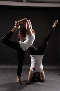 Pathak Yoga logo: Natarajasana & Shirshasana