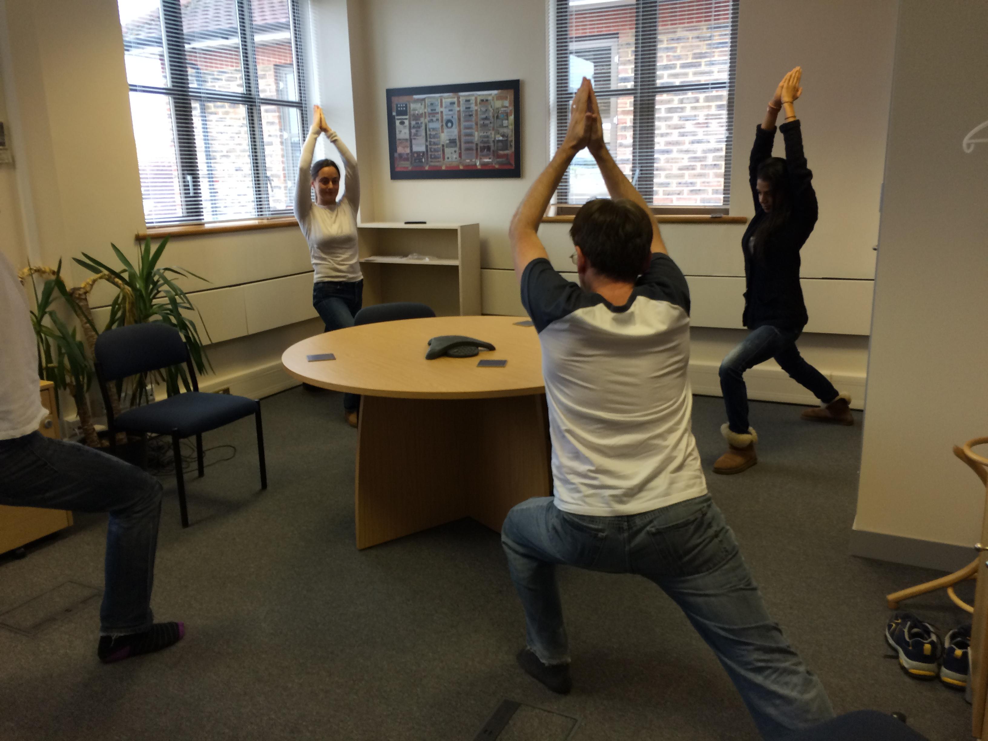 Virasana Warrior pose workplace yoga, office yoga, yoga everywhere, wellness week, desk yoga, chair yoga, corporate health and wellbeing champion, yoga London
