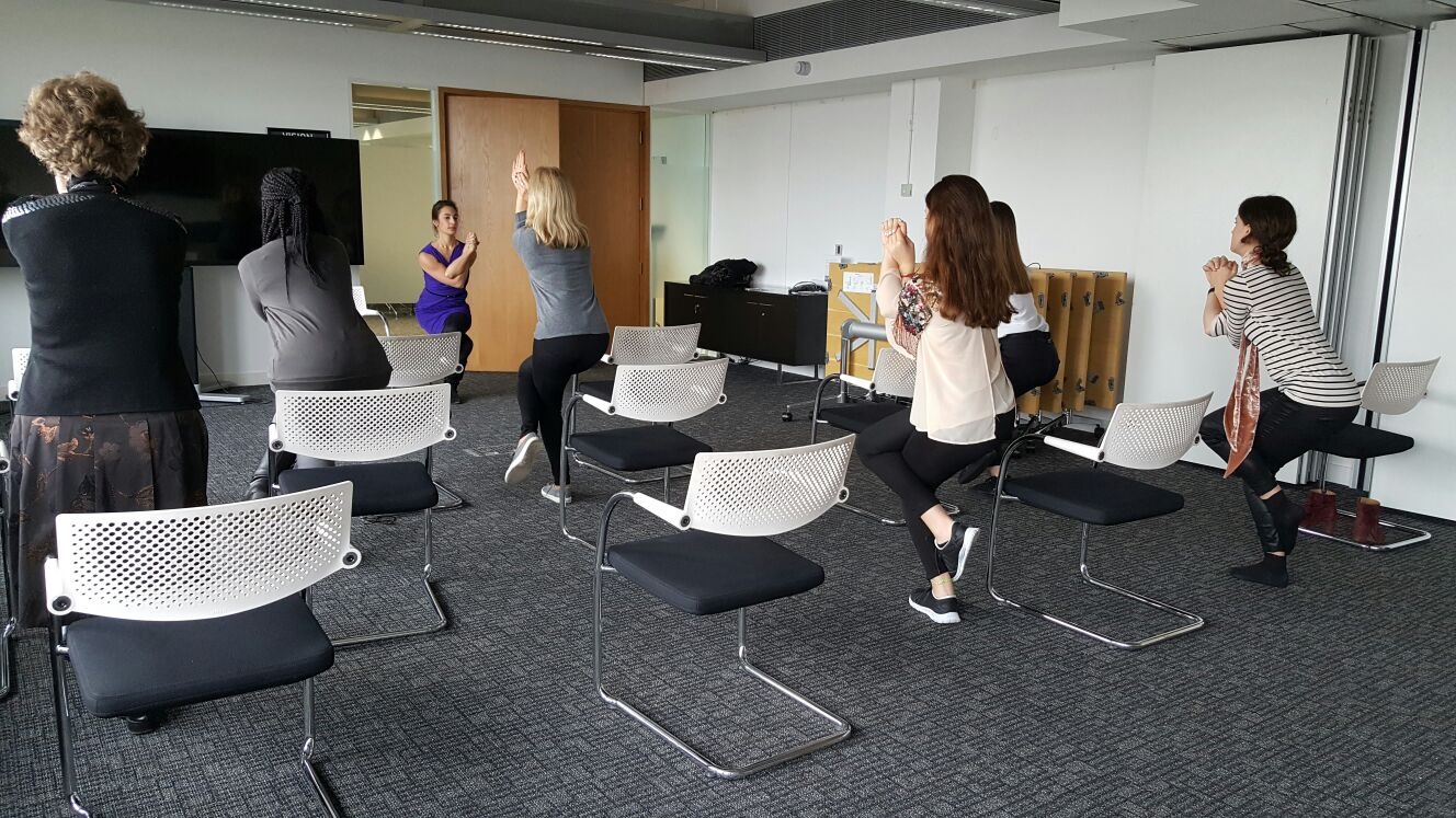 Desk and Chair Yoga Garudasana Eagle pose yoga pose workplace yoga, office yoga, yoga everywhere, wellness week, desk yoga, chair yoga, corporate health and wellbeing champion, yoga London