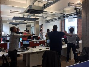 Hands and wrist exercise, workplace yoga, office yoga, yoga everywhere, wellness week, desk yoga, chair yoga, corporate health and wellbeing champion, yoga London