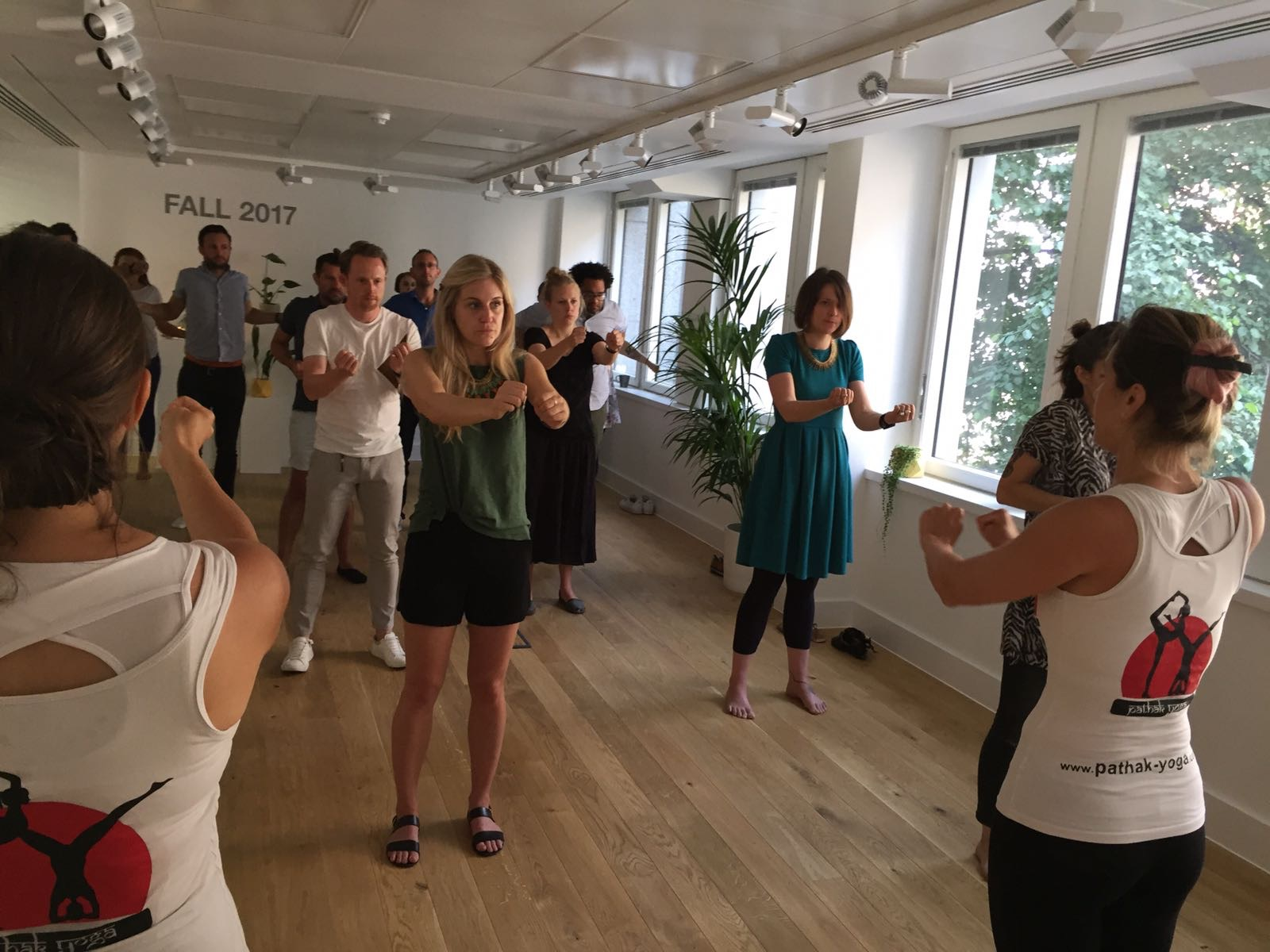 Standing yoga at GAP Suksham Vyayam yogic swimming workplace yoga, office yoga, yoga everywhere, wellness week, desk yoga, chair yoga, corporate health and wellbeing champion, yoga London