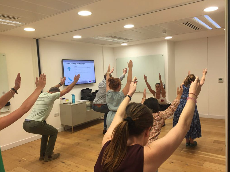 Office Yoga, Corporate Yoga, Standing yoga, Hotwire PR, Moorgate, Liverpool Street, Utkatasana, Chair Pose, workplace yoga, yoga, yoga everywhere, wellness week, desk yoga, chair yoga, corporate health and wellbeing champion, yoga London