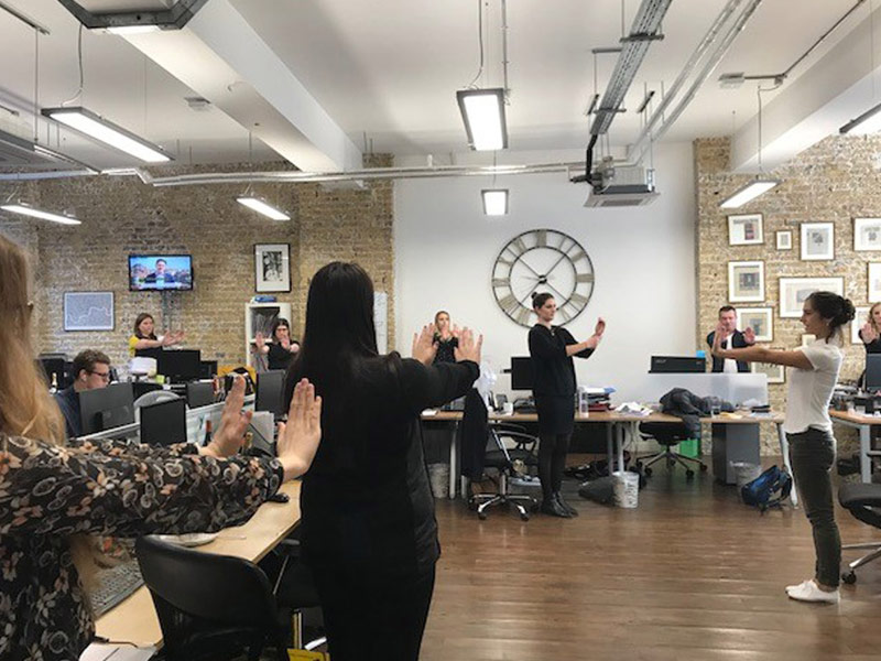 Corporate Yoga, Standing yoga, Rostrum Agency, Suksham Vyayama, Kriya, workplace yoga, office yoga, yoga everywhere, wellness week, desk yoga, chair yoga, corporate health and wellbeing champion, yoga London