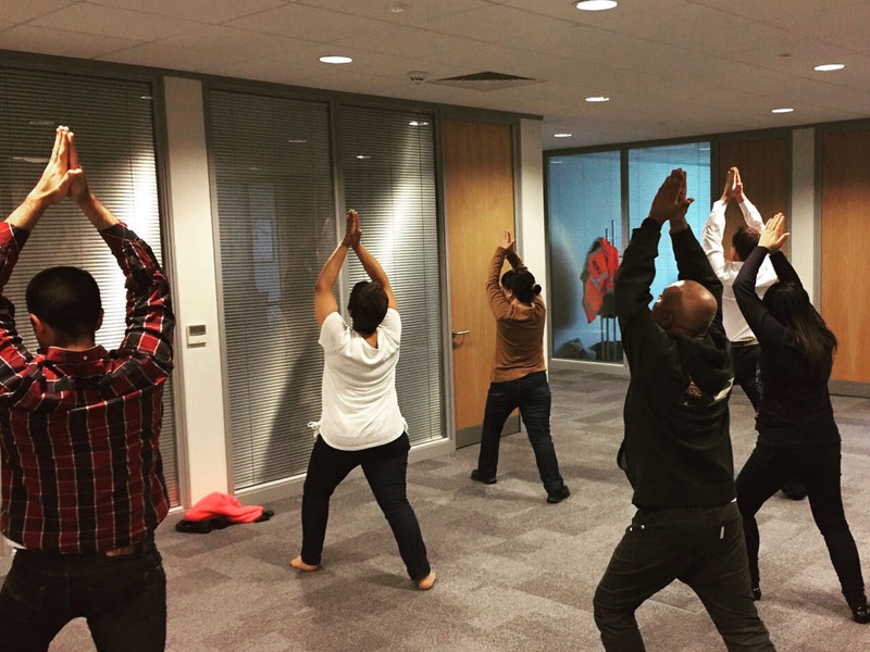 Office Yoga, Corporate Yoga, Standing yoga, Virabhadrasana, Warrior Pose, workplace yoga, yoga, yoga everywhere, wellness week, desk yoga, chair yoga, corporate health and wellbeing champion, yoga London