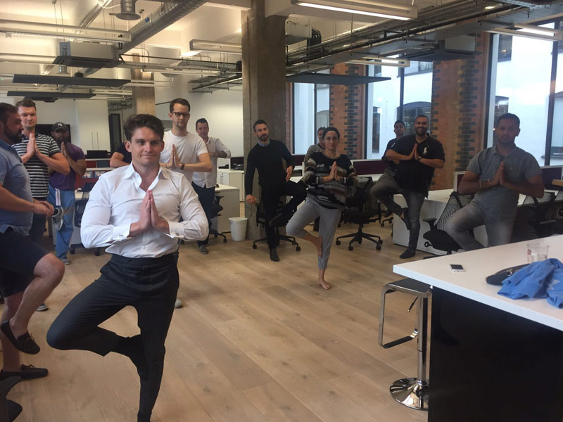 Office Yoga, Corporate Yoga, Standing yoga, KMG, Kau Media Group, Hammersmith, Vrikshasana, Vrksasana, Tree Pose, workplace yoga, yoga, yoga everywhere, wellness week, desk yoga, chair yoga, corporate health and wellbeing champion, yoga London